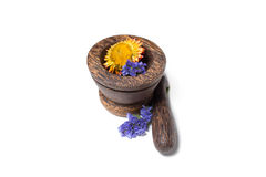 Wooden pounder with yellow and blue flowers Stock Photos