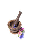 Wooden pounder with yellow and blue flowers Stock Photography