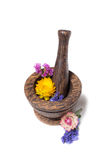 Wooden pounder with yellow and blue flowers Royalty Free Stock Image