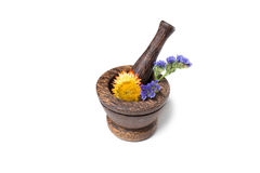 Wooden pounder with yellow and blue flowers Royalty Free Stock Photos