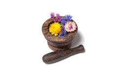 Wooden pounder with yellow and blue flowers Royalty Free Stock Photography
