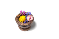 Wooden pounder with yellow and blue flowers Stock Photo