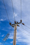 Wooden Power Electricity Pole Pylon,High Volage,Blue Sky Background Royalty Free Stock Image