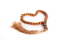 Wooden prayer bead on white Royalty Free Stock Photo