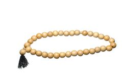 Wooden prayer beads isolated Stock Image