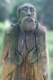 Wooden praying old man stock image