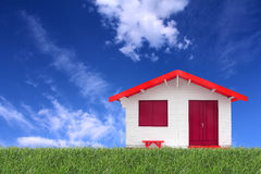 Wooden prefabricated house on the grass Royalty Free Stock Images