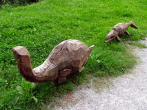 Wooden prehistoric animals. Prehistoric animals carved in wood Stock Photography