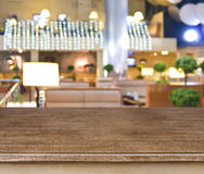 Wooden presentation table and blurred cafe background Royalty Free Stock Photos