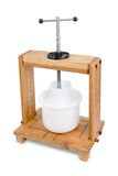Wooden press for cheese. Photos of the press cheese on a white background Stock Photography