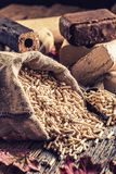 Wooden pressed pellets and briquettes from biomass. Wooden pressed pellets and briquettes from biomass with autumn leaves Stock Images