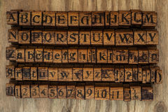 Wooden printing blocks alphabet and numbers Royalty Free Stock Photos