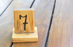 Free Wooden Priority Number 7 On A Plank Tab Royalty Free Stock Photo - 225247825