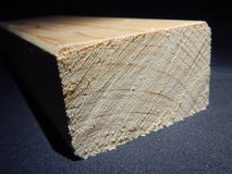 Wooden prism cut for another work. A wooden prism cut for another work royalty free stock image