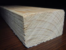 Wooden prism cut for another work. A wooden prism cut for another work stock images