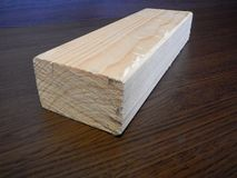 Wooden prism cut for another work. A wooden prism cut for another work stock photography