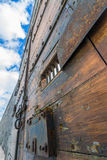 Wooden prison door and blue sky Royalty Free Stock Images