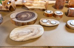Wooden products - trays, candlesticks and other handicrafts sold at farmers market. Handmade wooden products - trays, candlesticks and other handicrafts sold at royalty free stock photography