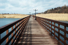 Wooden promenade with lanterns Royalty Free Stock Image