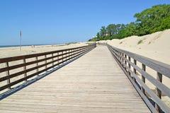 Wooden promenade on the sandy coast of the Baltic Sea. Settlement Amber, Kaliningrad region.  Stock Photo