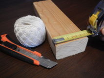 Wooden prosm with other tools for handy men Royalty Free Stock Image