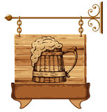 Wooden pub sign. With mug of beer Royalty Free Stock Photography