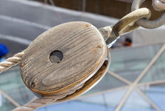 Wooden pulley on boat Stock Images
