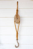 Wooden pulley with ropes Stock Photos