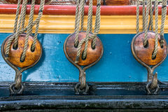 Wooden pulleys. Detail of three wooden pulleys on a classical sailing ship royalty free stock photo