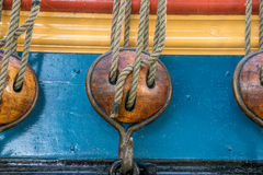 Wooden pulleys. Detail of three wooden pulleys on a classical sailing ship Royalty Free Stock Photos