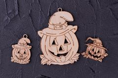 Wooden pumpkin tags on black background. stock image