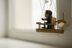 Wooden puppet in a ballonn. Wooden puppet in a balloon, looking out the window Stock Image