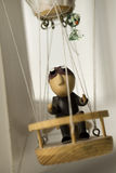 Wooden puppet in a balloon. Wooden puppet, with a cat, in a balloon, looking out the window Stock Images