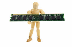 Wooden puppet carries a computer memory module Royalty Free Stock Photos