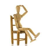 Wooden puppet on chair Royalty Free Stock Photos