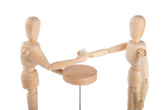 Wooden puppet couple having a drink Stock Photos