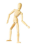 Wooden puppet is dancing . Isolated background . Stock Photos