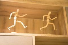 Wooden puppet Decorative wood. Two men decoration in shelf royalty free stock image
