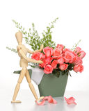 Wooden puppet happy with pink rose Stock Image