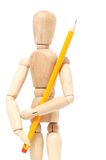 Wooden puppet holding pencil Stock Photography