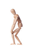 Knee pain. Wooden puppet with knee pain Royalty Free Stock Photo