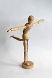 Wooden puppet man doing exercises Stock Photography