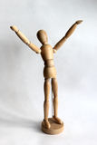 Wooden puppet man rejoices Stock Images
