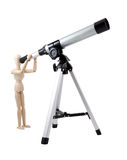 Wooden Puppet Observing with Telescope Royalty Free Stock Photos