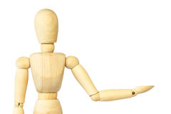 Wooden puppet is presenting something . Blank area at left side for fill your product . Isolated background . Royalty Free Stock Photography