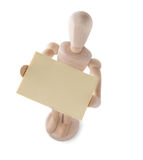 Wooden Puppet Raising Notepaper Royalty Free Stock Photography