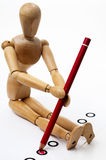 Wooden puppet and red voting pencil Stock Images