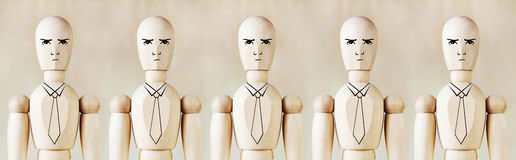 Wooden puppets as impersonal office staff Royalty Free Stock Image