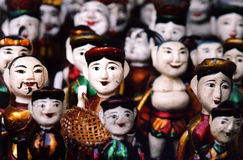 Wooden puppets, Hanoi, Vietnam. Wooden puppets stacked together on the floor of a shop in Hanoi, Vietnam royalty free stock images