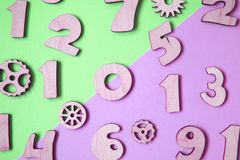Wooden purple numbers on pastel colored background. royalty free stock photos